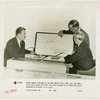 General Electric - Grover Whalen and Owen D. Young looking at map showing coverage of shortwave radio