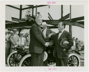 General Motors - William S. Knudson and Grover Whalen shaking hands