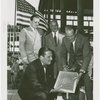 Glass Center - Grover Whalen and glass officials with glass block for cornerstone