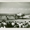 Howard Hughes' airplane with onlookers