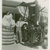 Hall of Invention - Man standing next to nude woman in cotton bale