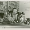 Hall of Invention - Telephone operator with antique telephones