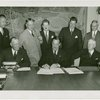 Hall of Pharmacy - Grover Whalen signing contracts with officials