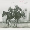 Indian (Native American) Participation - Two Haskell Institute guards on horseback jumping