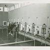 Infant Incubator - Men and women looking at babies in incubators
