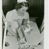 Infant Incubator - Nurse weighing baby