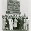 Information Booths - Group of men and women at dedication of Mayor's Official World's Fair Housing Bureau information booth