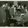 International Business Machines (IBM) - Woman demonstrates card punching machine to group of girls