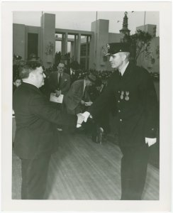 LaGuardia, Fiorello, H. - Decoration Ceremonies - Shaking hands with officer