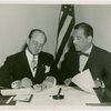 Luxembourg Participation - William H. Hamilton (Commissioner General) and Grover Whalen sign contract