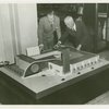Man Building - Walter Hoving (Lord and Taylor) and John Starbuck look at model