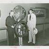 Marine - Admiral Land steers ship wheel