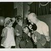 Marionettes - Man showing marionettes to boy and girl