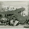 Medicine and Public Health - Diorama of radium being loaded onto airplane (Francis Rigney)