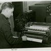 New York World's Fair - Employees - Man loading automatic sorter machine