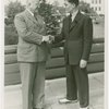 New York World's Fair - Employees - Gibson, Harvey (Chairman of Board) - Shaking hands with boy