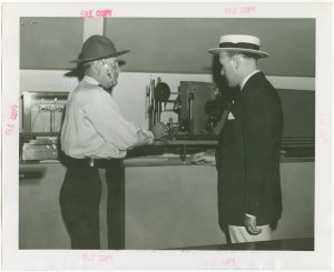 New York World's Fair - Employees - Police - Inspecting Spectograph at police exhibit