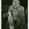 New York Zoological Society - Man standing next to stuffed ape in exhibit