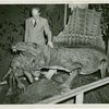 New York Zoological Society - Man next to alligator in exhibit