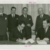 Nicaragua Participation - Noel Ernesto Pallais (Consul General) signs contract, Grover Whalen and group look on