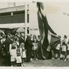 Norway Participation - Raising flag in front of building