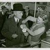 "Opening Day - 1940 Season - Woman pinning """"Hello Folks"""" label on John Rockefeller"