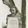 Woman holding Pittsburgh Plate Glass Co. Estimator of Attendance