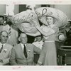 Puerto Rico Participation - Woman putting hat on Blanton Winship (Governor General)