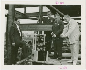 Radio Corporation of America (RCA) - Group standing in construction site with television