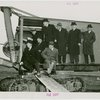 Railroads on Parade - Grover Whalen, J.M. Davis (President of the Delaware, Lackawanna, and Western Railroad and Chairman of World's Fair Committee of Eastern President's Conference), and officials on steam shovel at ground breaking