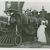 Railroads on Parade - Man and woman in costume standing next to train