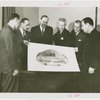 Restaurants - Grover Whalen and group holding sketch of Casino of Nations