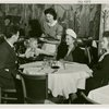 Restaurants - Childs - Childs waitress serving food to family: Celela Bonner, Child's waitress, serving Chattanooga, Tennessee family: (left to right) Mr. R.F. Lowe, Carolyn Joyce Lowe (3 years old), Mrs. Lowe, and Betty Fritz Lowe.