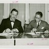 Siam official and Grover Whalen signing contracts