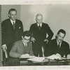 Syrian officials and Grover Whalen signing contract