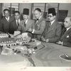 Syrian officials view model