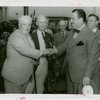 Special Days - Grover Whalen and founder shake hands at Lions Day