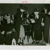 Special Days - Rural Women's Day - Woman presenting Eleanor Roosevelt with orchids
