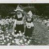 Special Weeks - Tulip Week - Girls in costumes looking at tulips