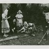 Special Weeks - Tulip Week - Grover Whalen with costumed youth planting bulbs
