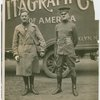 Sports - Two men in uniforms in front of [V]itagraph Co. truck.