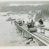 Sports - Hannes Schneider going up ski lift in North Conway, N.H.