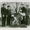 Sports - E.W. McKee, Howard Fanigan, Caption of Navy crew team and Christy Walsh with trophies and stuffed goat