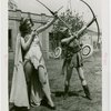 Sports - Archery - Two woman in costumes aiming bows