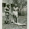 Sports - Archery - Two women in costumes with bows looking at dead deer