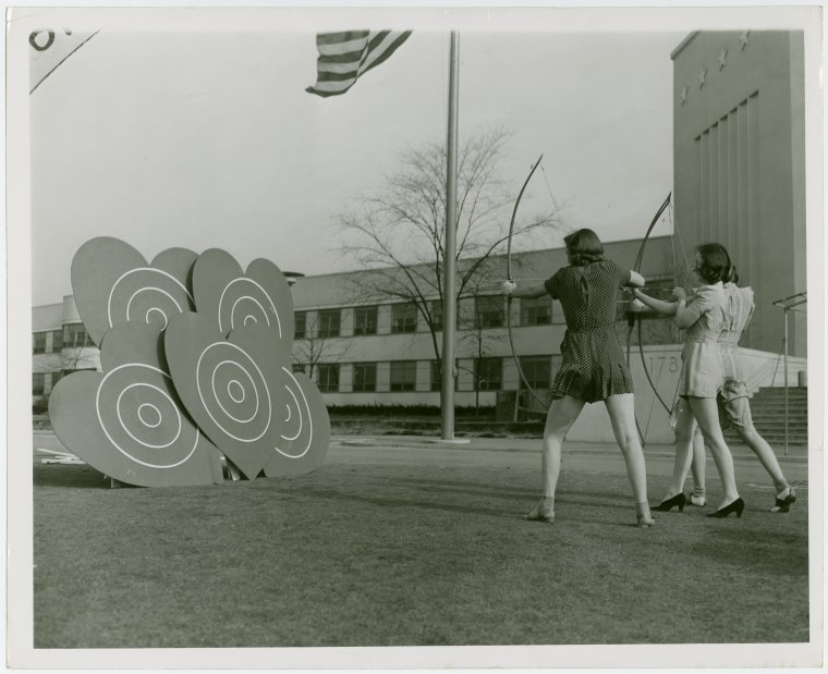 Sports - Archery - Group of women aiming at heart shaped targets