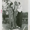 Sports - Baseball - Leo Durocher at microphone with boy scout and other man