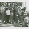 Sports - Baseball - Joe DiMaggio showing certificate while Red Rolfe talks to boys