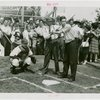 Sports - Baseball - Ernie Quigley, Moose McCormack and Morrie Arnovich teaching boy how to bat