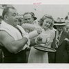 Sports - Boxing - Tony Galento receiving glass of milk from woman